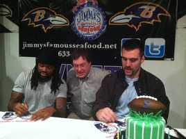 Ravens players Joe Flacco and Torrey Smith take photos with and sign autographs for fans at a special dinner at Jimmy's Seafood in Dundalk.
