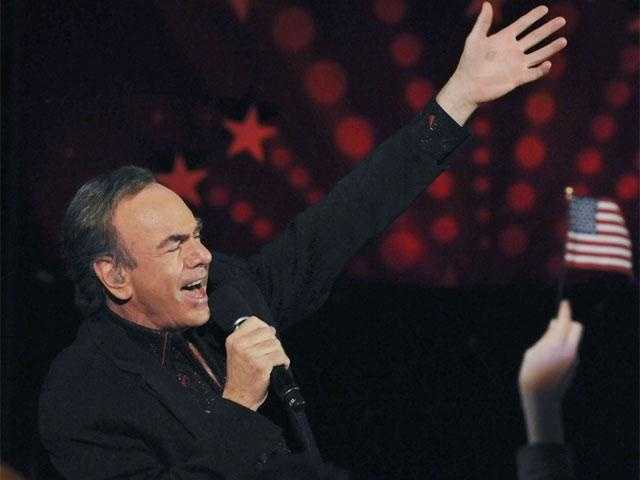 """Boston's song is """"Sweet Caroline.""""  That's Neil Diamond singing before a half million people at the 4th of July Concert in Boston."""
