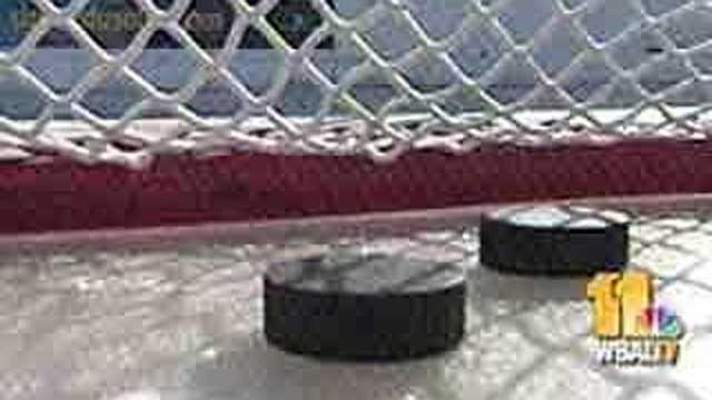 Hockey pucks in net