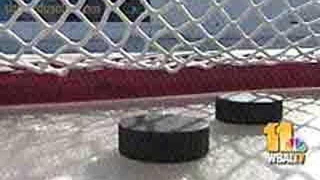 Hockey pucks in net