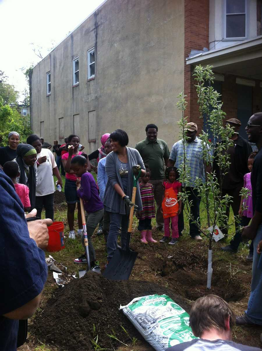 Dozens of people participating in Baltimore's annual Spring Cleanup on Saturday also took part in the Power In Dirt initiative.