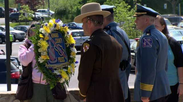 Police officials unveiled a plaque in the memorial garden at the Howard County Police Department headquarters building.