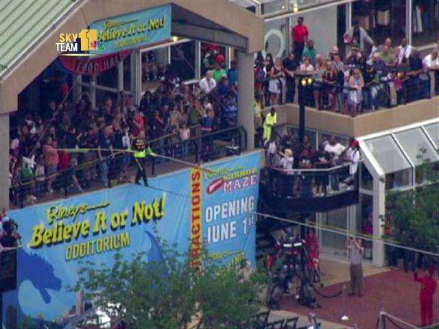 The death-defying act promotes the new Ripley's Believe It or Not Odditorium, scheduled to open June 1 at the Light Street Pavilion.