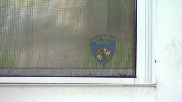 A Baltimore City police decal was seen on the door of Unni's townhouse. Baltimore City police confirmed Unni was a former Baltimore City Police Department crime lab technician, not a police officer. Unni separated from the agency in 2005.