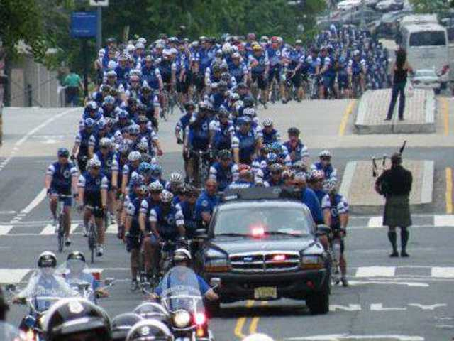 The Police Unity Tour gets a, well, police escort through Ellicott City.