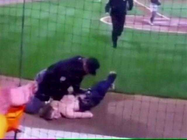 One fan who ran onto the field was even tackled at home plate by an umpire.