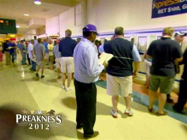 Horse-racing fans and novices alike line up to place their bets.