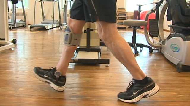 Dave Moriconi demonstrates how a device worn on his leg helps him walk after a paralyzing injury.