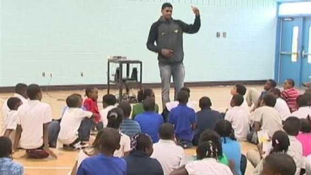 Rudy Gay talks with students at Frederick Elementary School.