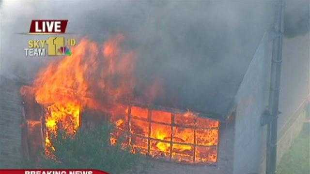 A massive fire consumes a house near the Marley Station Mall.