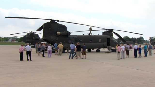 Crews prepared six Chinook aircraft at a nearby airfield for transport for use in Afghanistan.