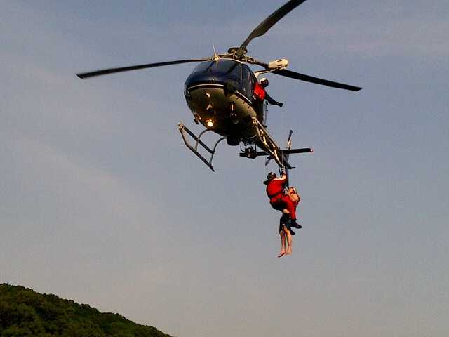 Several rescue crews were called in to help, and the man was hoisted into the air by helicopter to get him off the dam.