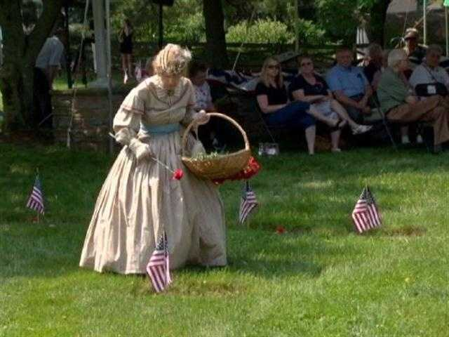 A woman named Jeanie Walden donned a Civil War-era dress, as she does every year, and placed a flower on the graves of those buried in what's called the Circle of Immortals.
