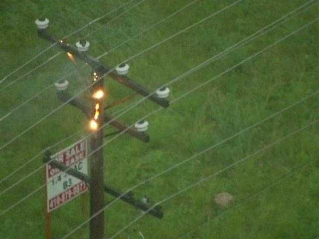 Sky Team 11 captures a utility pole catching fire in the Fallston area after the storm blew through.