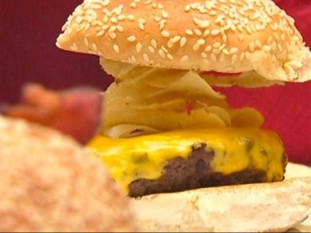 """Our signature is something called the crunch burger, where you can get any burger crunchified, as we like to call it. It's thin, crispy potato chips on any burger, and it's free,"" Flay said."
