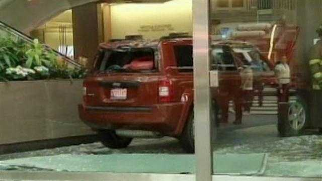 SUV INTO BUILDING