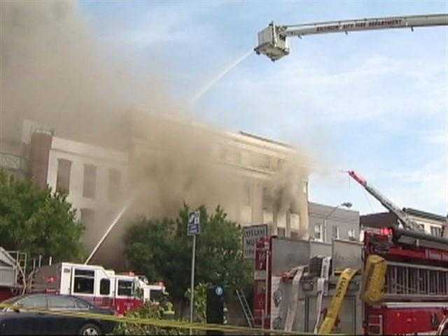 Crews were called to the 500 block of S. Broadway Street at about 1:40 p.m. Monday, where they were met with heavy smoke and fire shooting through the roof of a four-story vacant brick building.