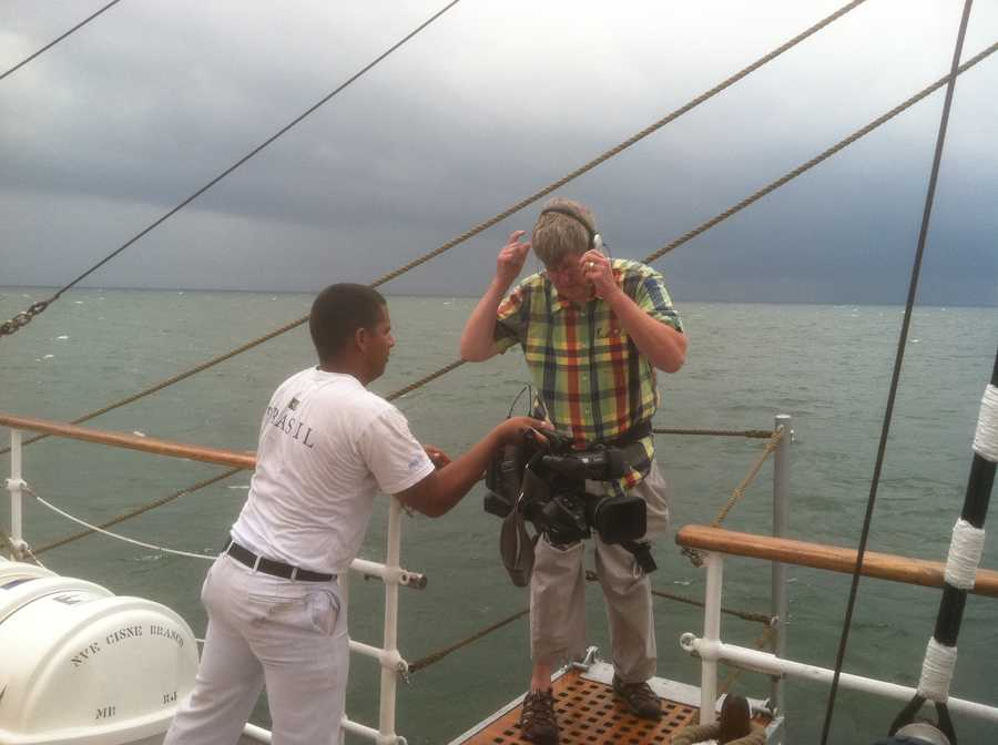 11 News videographer Chuck Cochran goes out on a limb -- or plank -- on the Cisne Branco for some good video.