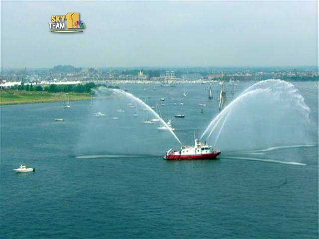 A little further out, the Baltimore City fire boat saluted the ships.