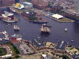 The Pride of Baltimore II led the parade of tall ships into the harbor on Wednesday, and it led the parade Tuesday as the vessels left.
