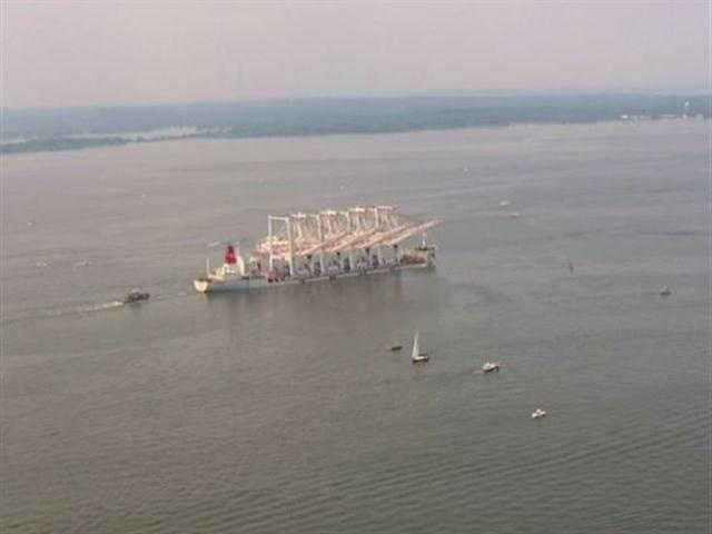 In preparation for their final leg that would require them to transit under both the Chesapeake Bay Bridge and the Francis Scott Key Bridge in Baltimore, the cranes underwent a multi-day process to further lower their booms in order to fit under both bridges.