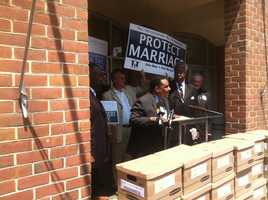 Opponents of same-sex marriage in Maryland protest the new law and deliver signatures to petition the issue to the November ballot.