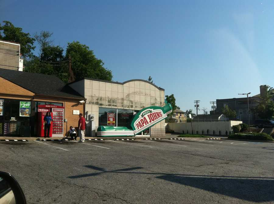 Sign falls off pizza shop on Falls Road in north Baltimore.