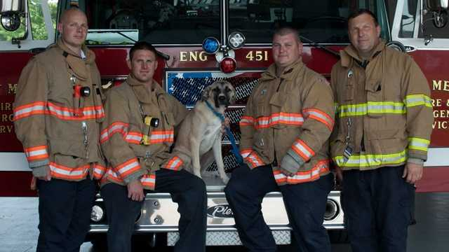 Beau, seen here with some members of the Fort Meade Fire Department.