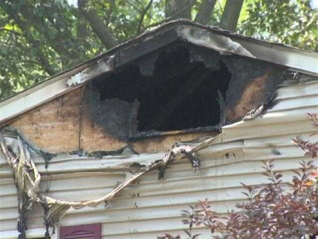 Fire crews were dispatched to the 3400 block of Newport Avenue in Annapolis at about 10 a.m. Sunday, where arriving firefighters said they saw flames shooting through the roof of a two-story single-family house.