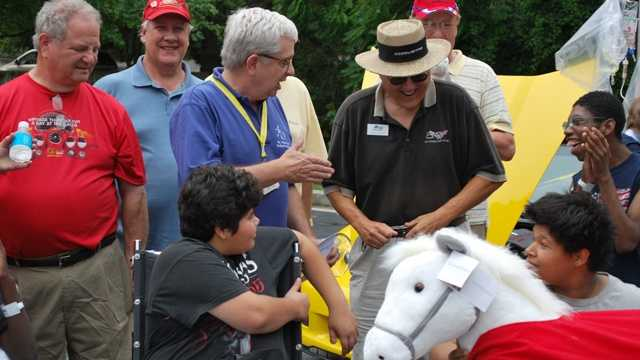 Corvette owners from the National Corvette Restorers Society Mason-Dixon Chapter drive smiles to the faces of kids at Mt. Washington Pediatric Hospital, showing the youngsters late-model Corvettes and presenting a generous donation.