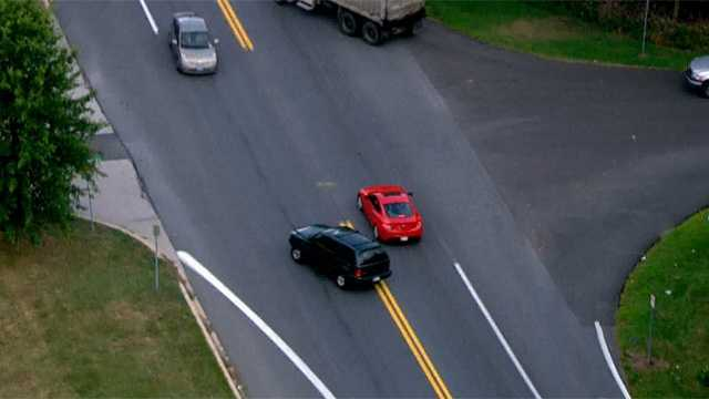 Approaching another vehicle, the SUV driver seemed to hesitate for a moment before crossing the double-yellow line.