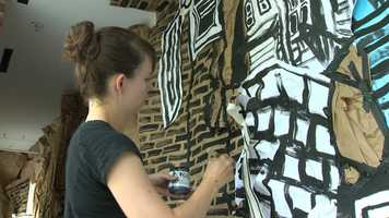 She's making a window display at MICA's Fox building on Mount Royal Avenue.