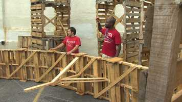 The venue is being built using 350 shipping palates made from reclaimed materials.
