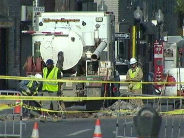 As many as 40 businesses were evacuated until BGE crews complete repair work on a gas line under the sinkhole. Gas service was shut off to 14 businesses.