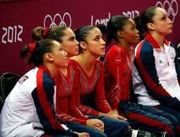 No. 5: In women's gymnastics, Team USA watches the scoreboard that would later display their gold medal-winning score.