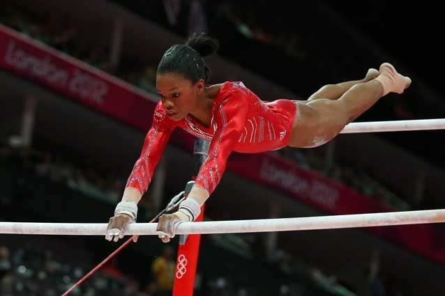 No. 2: Team USA's Gabby Douglas, on the uneven bars, nails a difficult transition from lower bar to upper bar and follows with a great landing.