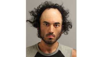 Kyle Tanner, 25, is arrested on disorderly conduct and reckless endangerment charges after police say he yelled at Annapolis movie theater patrons during a showing and simulated having a gun.