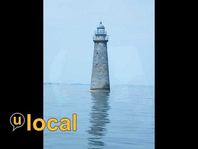 Minots Ledge Light, located one mile offshore from the towns of Cohasset and Scituate, MA