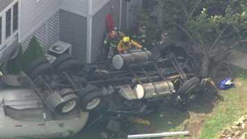 Several homes and area businesses were evacuated Tuesday after a tractor-trailer carrying propane crashed into a condominium complex in Cecil County, and many who live at the complex were still not allowed in their homes Wednesday.
