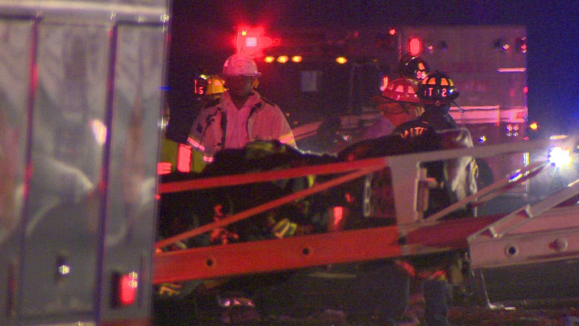 Fire officials said lumber was strewn all over the roadway.