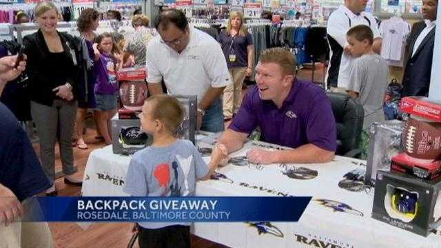 Matt Birk helps kids get the school supplies they need at Walmart.