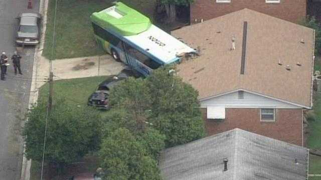 Emergency crews in Montgomery County are investigating a crash that sent a bus into a house in Silver Spring.