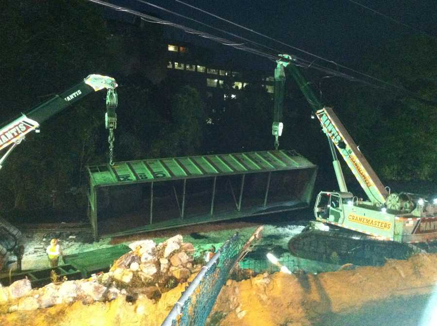 Early Thursday morning, crews remove the last of the 21 derailed train cars from the scene.