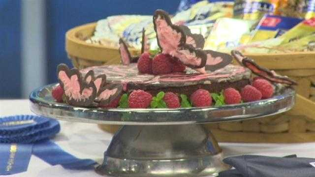 Ingredients:Magic Butterfly TorteTorte:1 (12 ounce) bag Ghirardelli Dark Chocolate Baking Chips, divided1 (6 ounce) container raspberry yogurt4 roasted almond granola bars, crushed1 cup egg whites (approximately 7 eggs)1/2 cup powdered sugar2 teaspoons raspberry flavoring for coffeeButterflies:Ghirardelli Chocolate Baking ChipsGhirardelli White Chocolate Baking ChipsRed food coloring