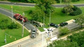 Taylor said city police shut down the ramp and one lane of westbound Cold Spring Lane so tow trucks could upright the vehicle.