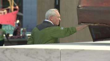 A man visiting the World Trade Center memorial in Baltimore stops to reflect on Sept. 11, 2012.
