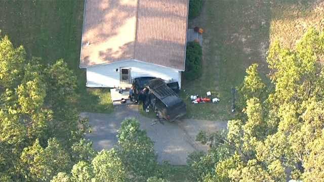 SUV into house from chopper