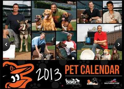 The $15 calendars benefit the animals at BARCS. Other BARCS items were also available for purchase for the O's to sign.