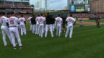 Immediately after Sunday's game, about two dozen players and coaches took scoreboard watching to a new level by staying on the field at Camden Yards and rooting for the Texas Rangers to win the opener of a double-header against the Los Angeles Angels.