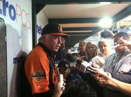 Buck Showalter speaks with the media in the dugout at St. Petersburg, Fla.